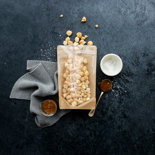 Popcorn packaged in a transparent stand up gusset back